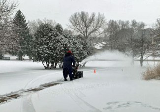 My husband snowblowing the driveway
